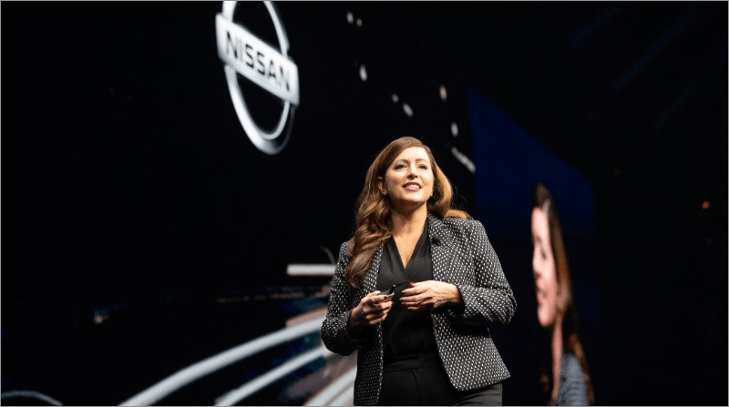 Nissan executive speaking on stage