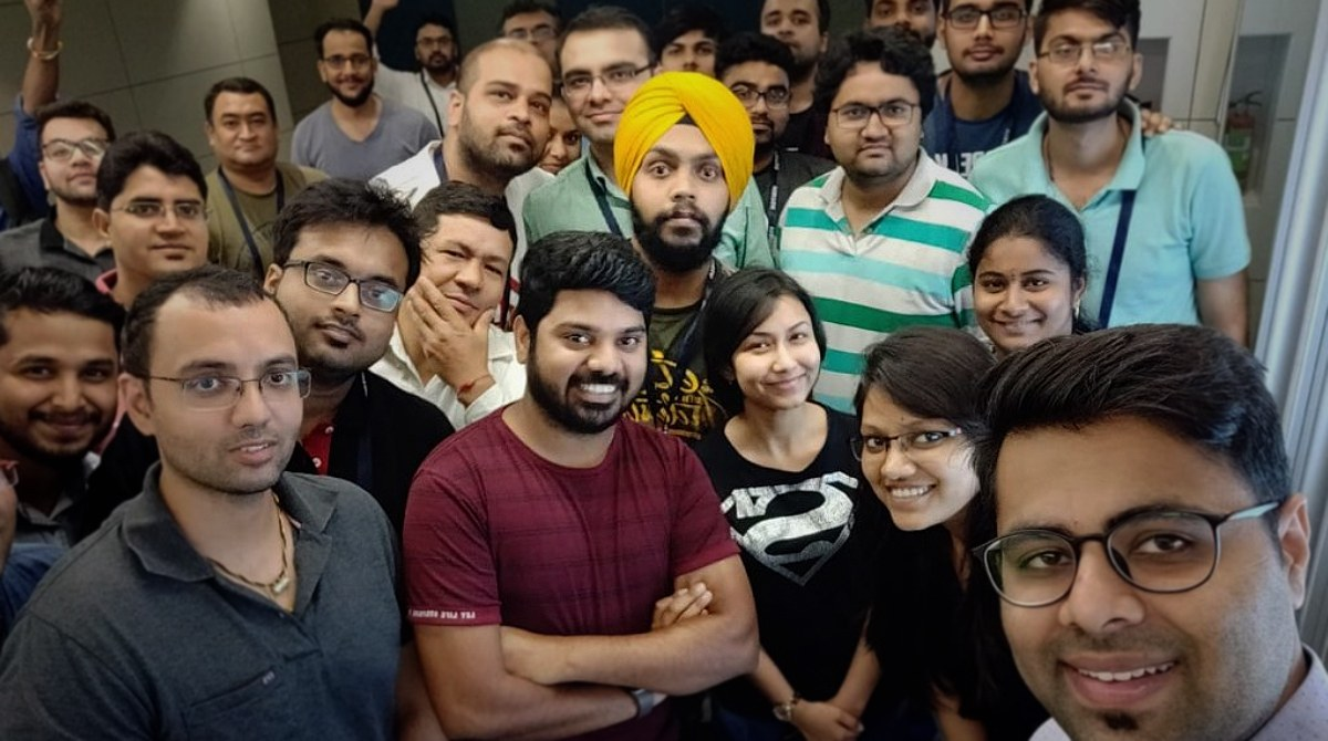 Lakshmi at the Delhi Tableau User Group in 2018. Lakshmi is pictured in the middle wearing a red t-shirt.